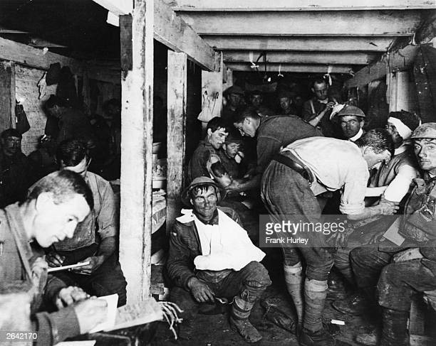 British tommies relaxing and having wounds treated in an underground forward dressing station by the Menin Road in France.
