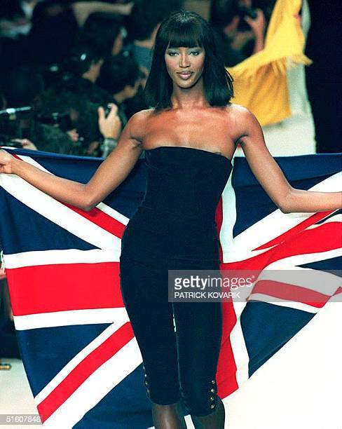 British top model Naomi Campbell presents a black stretched velours catsuit with a shawl in the colors of the British flag created by Karl Lagerfeld...