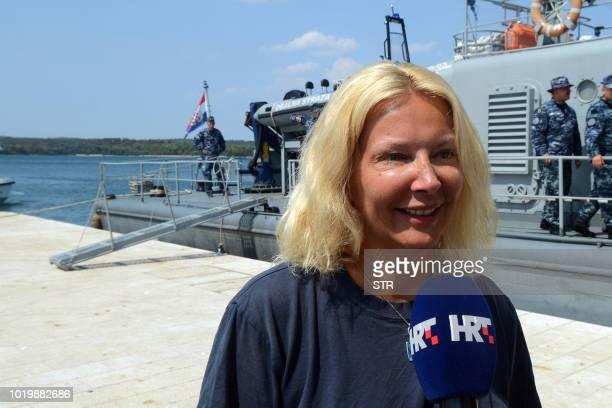 British tourist Kay Longstaff speaks to the press upon her arrival in Pula with the Croatias coast guard ship on August 19 which saved her after...