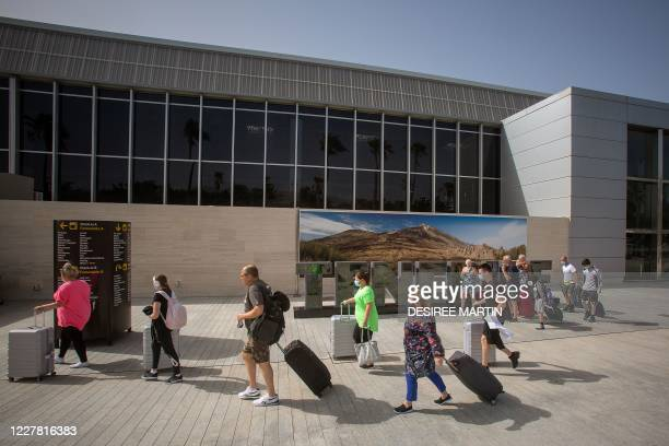 British tourists arrive at the Tenerife Sur Reina Sofia airport on the Canary Island of Tenerife on July 28, 2020. - After Britain's quarantine move...