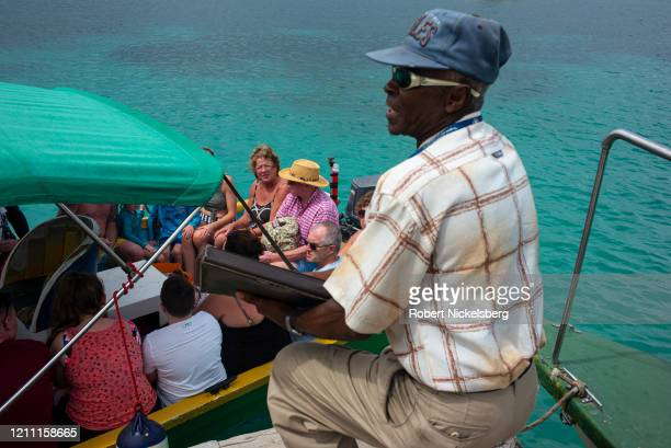 British tourists board a water taxi on the Grand Anse Beach before returning to the P&O Britannia cruise ship docked in St. Georges, Grenada February...