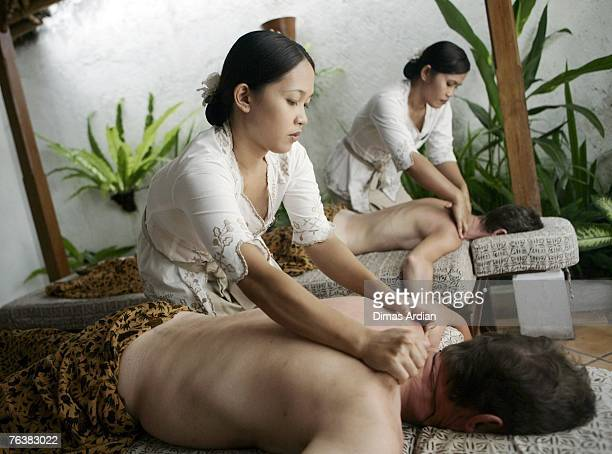 British tourists receive massages during a spa treatment at Bali Tropical Spa on August 29 2007 in Bali Indonesia Bali now has the highest...