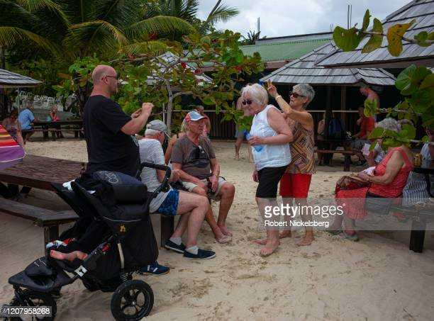 British tourists traveling on the P&O Britannia cruise ship spend time on the Grand Anse Beach in St. Georges, Grenada February 17, 2020. The British...