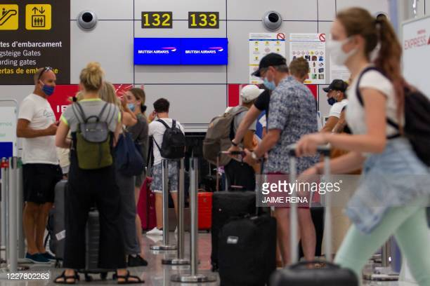 British tourists wait to check in for a flight to London at the airport in Palma de Mallorca on July 27, 2020. - Tour operator TUI has cancelled all...