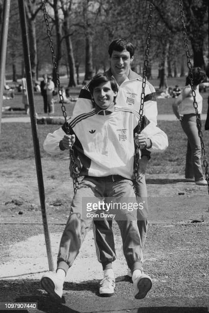 British track and field athlete Allan Wells pushes Sebastian Coe on a swing UK 24th April 1984
