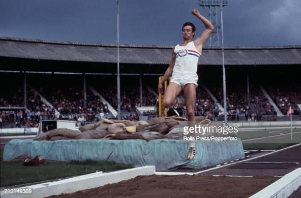 British track and field athlete Lynn Davies pictured in action competing in the long jump event at an Olympic trials athletics meeting at White City...