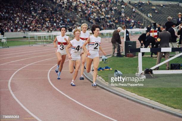 British track athletes Pat LoweCropper and Joan Page lead West German track athletes Hildegard Falck and Sylvia Schenk in the women's 800 metres...