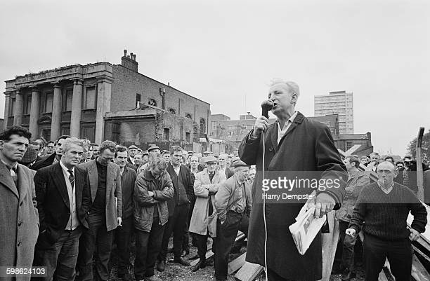 British trade union leader Jack Dash , chairman of the Port Workers Liaison Committee speaks at the Royal Docks, London, during the dockers' strike,...
