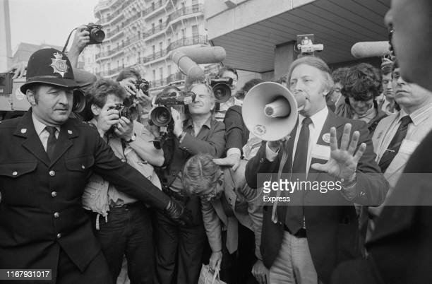 British trade unionist Arthur Scargill talks to demonstrators asking for a 24-hours strike to support miners outside a TUC conference, UK, 3rd...