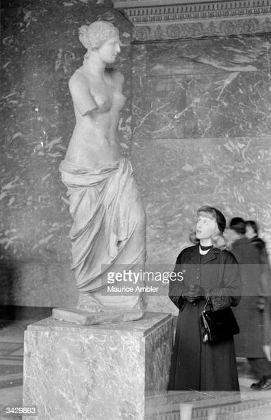 Transsexual Roberta Cowell, formerly Robert Cowell admires the Venus de Milo in the Louvre during a visit to Paris. Roberta was once a Spitfire...
