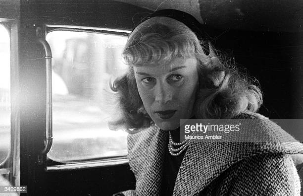 Transsexual Roberta Cowell, formerly Robert Cowell in a Paris taxi. Roberta was once a Spitfire pilot, prisoner-of-war, racing motorist, husband and...