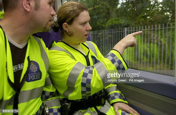 British Transport Police Constable Rebecca Lamb alerts her colleague PC Ian Gathercole to something suspicious as they travel aboard a C2C QTrain...