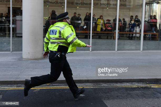 British Transport Police officer runs along a street after reports of shots being fired on London Bridge on November 29 2019 in London England Police...