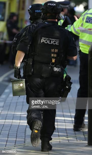 British transport police officers work outside Parsons Green underground tube station in west London on September 15 following an incident on an...