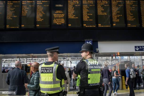 British Transport Police watch on as people wait to board trains to Windsor to watch the Royal Wedding of Prince Harry and Meghan Markle at Waterloo...