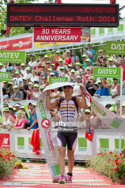 British triathlete Rachel Joyce crosses the finishing line to take second place during the Datev Challenge Roth inRoth Germany 20 July 2014 The...