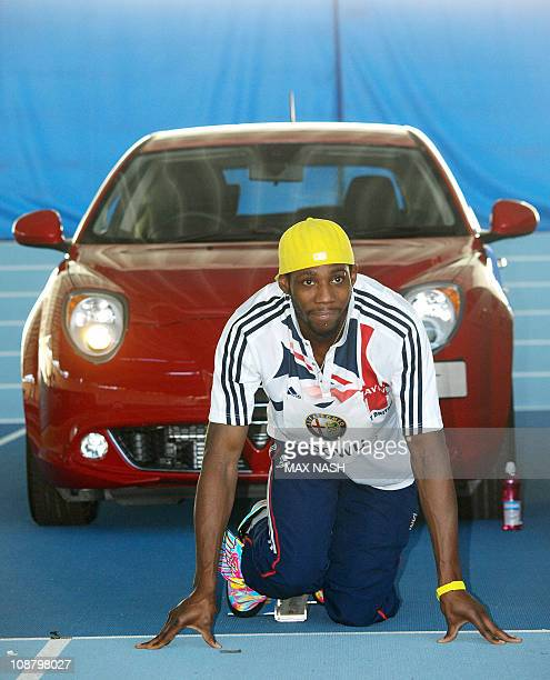 British triple jump champion Philips Idowu practises in the blocks as he poses for photographers during the launch of the new Alfa Romeo MiTo Sprint...