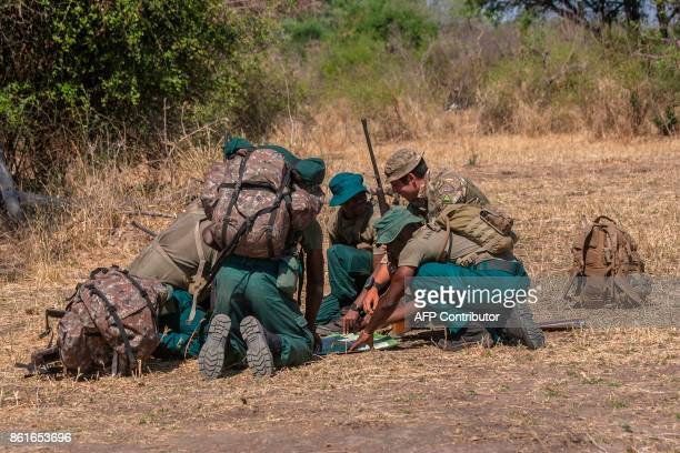 British trooper and Counter Poaching Operator Samuel Knuckey leads participants in GPS and Map Reading training session during Counter Poaching...
