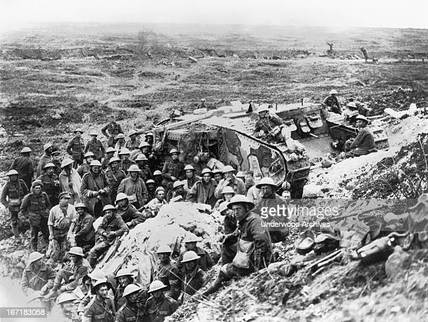 British troops and a Mark I tank two days after the fall of Flers Flers Somme France September 24 1916 The Battle of Flers–Courcelette during the...