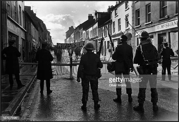 British troops and Irish police stop a People's Democracy march from proceeding through downtown Armagh Northern Ireland 1972 The British Army later...