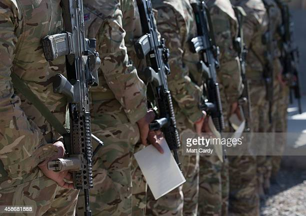British troops and service personal remaining in Afghanistan are joined by International Security Assistance Force personnel and civilians as they...