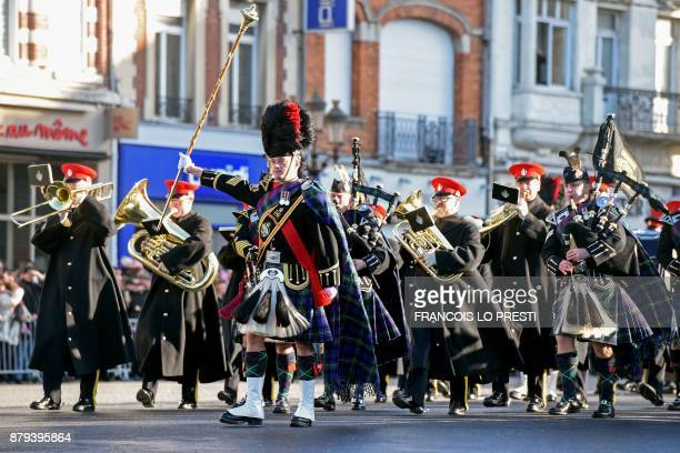 British troops and the Pipe Major from the Royal Tank Regiment parade during a commemoration ceremony for the centenary of the Battle of Cambrai on...