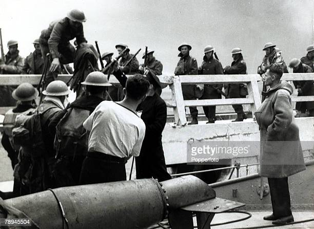 British troops being helped board rescue craft from the pier, The Battle of Dunkirk during World War II, (which took place approx, 25th May - 3rd...