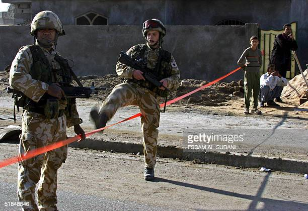 British troops cordon an area following a bomb blast in the southern city of Basra 11 December 2004 Some 200 soldiers from Britain's Black Watch...
