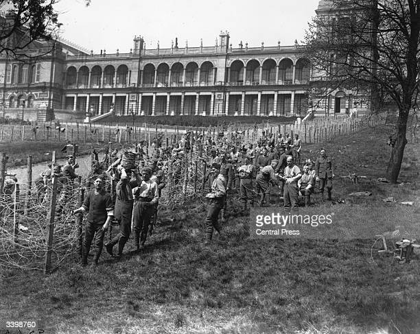 British troops erecting barbed wire enclosures outside Alexandra Palace North London to imprison German prisoners of war