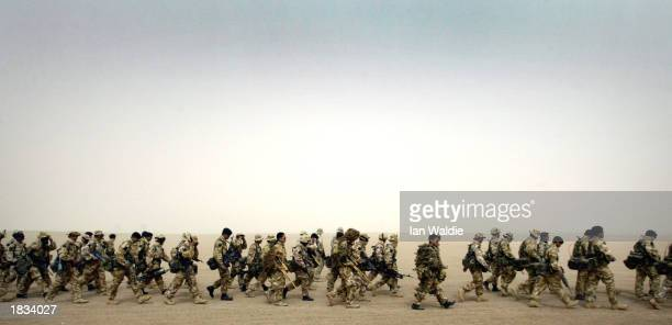 British troops from 1 Royal Irish Regiment march through the desert at Camp Eagle March 7 2003 near Kuwait City Kuwait British General Sir Michael...