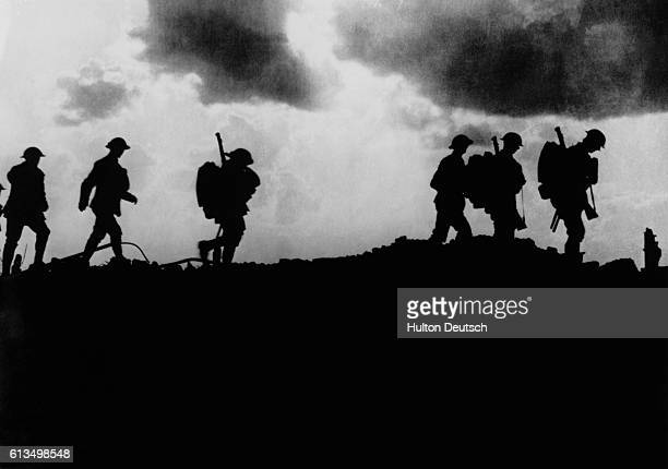British troops in silhouette march towards trenches near Ypres at the Western Front during the First World War In the first Battle of Ypres October...