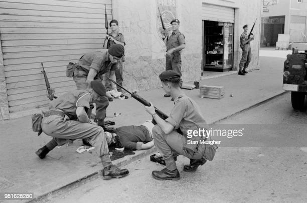 British troops of the 42 Royal Commando gather around Danish Sea Captain Johanne Theison after being shot by terrorists in Aden Yemen October 1967