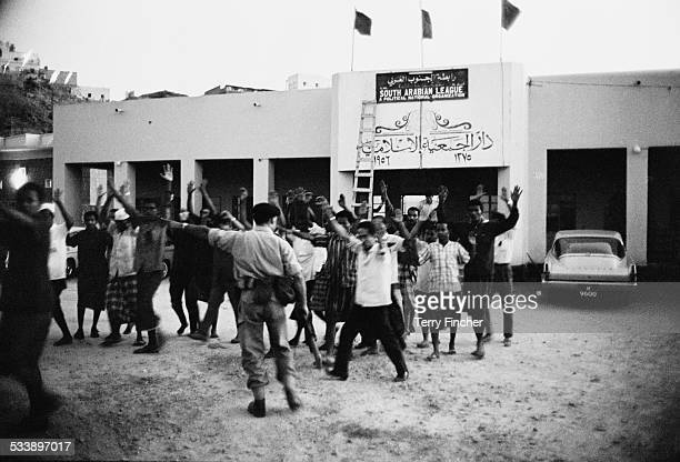 British troops of the Northumbrian Fusiliers arrest and search members of the nationalist South Arabian League at the organisation's headquarters in...