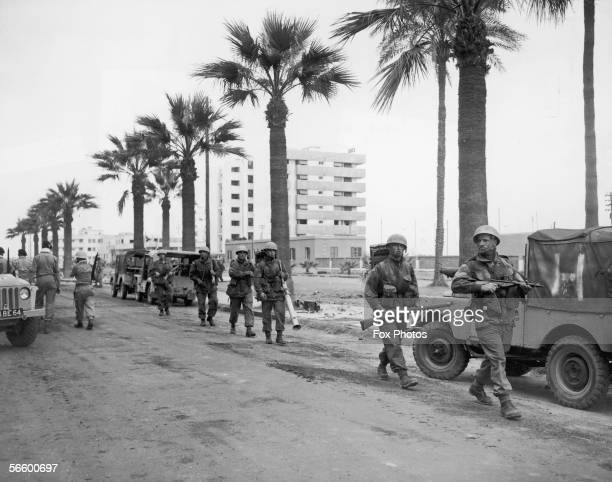 British troops patrolling a street in Port Said, Egypt during the Suez Crisis, 12th November 1956.
