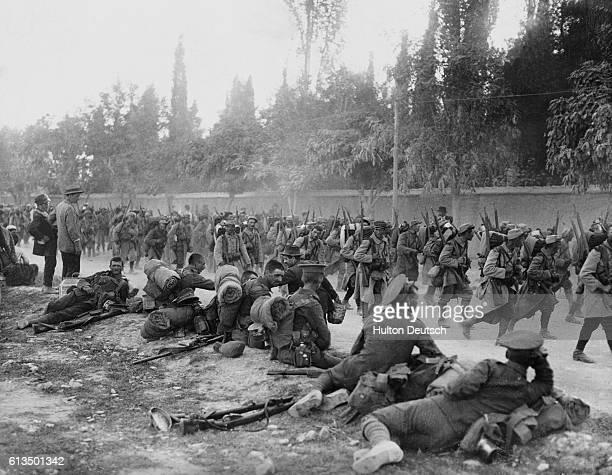 British troops rest at a roadside as French troops march by during the Balkan offensive of the First World War Austria Germany and Bulgaria invaded...