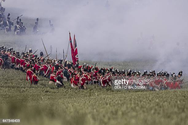 British troops shrouded by rifle and cannon smoke Battle of Waterloo 1815 Napoleonic Wars 19th century Historical reenactment
