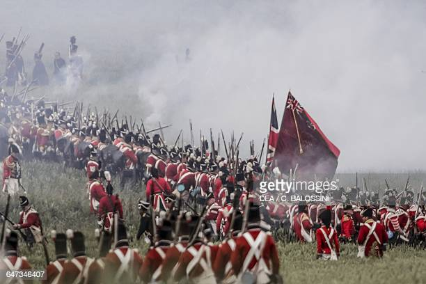 British troops shrouded in rifle smoke Battle of Waterloo 1815 Napoleonic Wars 19th century Historical reenactment