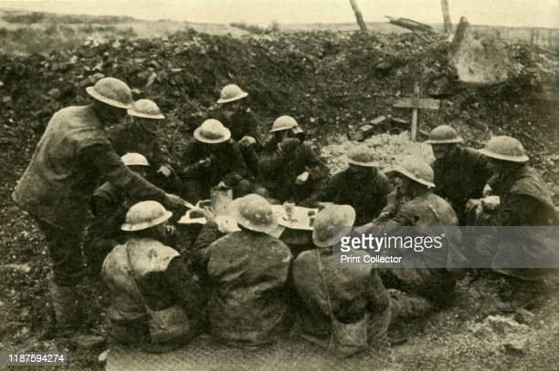 British troops spend Christmas on the battlefield First World War circa 1916 'Yuletide on the Western Front Tommy's Christmas dinner in a shellhole'...