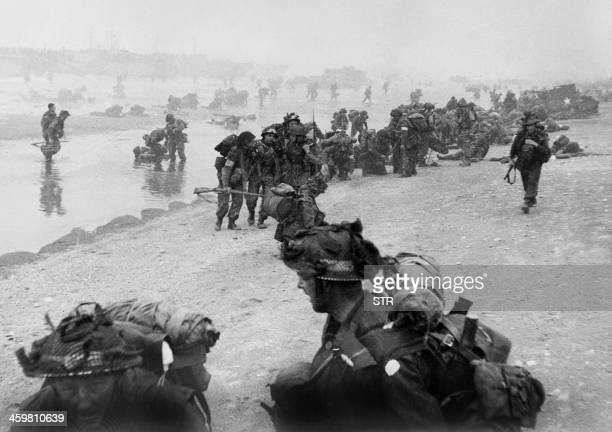 British troops take positions on Sword beach during D-Day 06 June 1944 after Allied forces stormed the Normandy beaches. D-Day, 06 June 1944 is still...