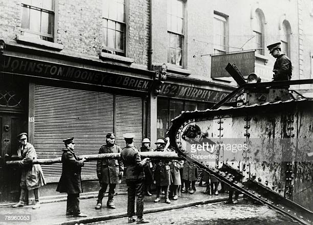 British troops using a Mark V tank and a battering ram to break down the door of a Johnston Mooney O'Brien bakery at 153 Capel Street Dublin during...
