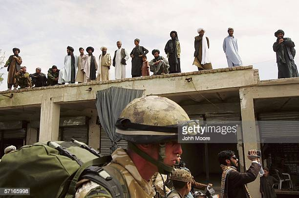 British troops walk into Mus Qala in the southern Afghan province of Helmand on March 23 2006 An advance team of British soldiers has been meeting...