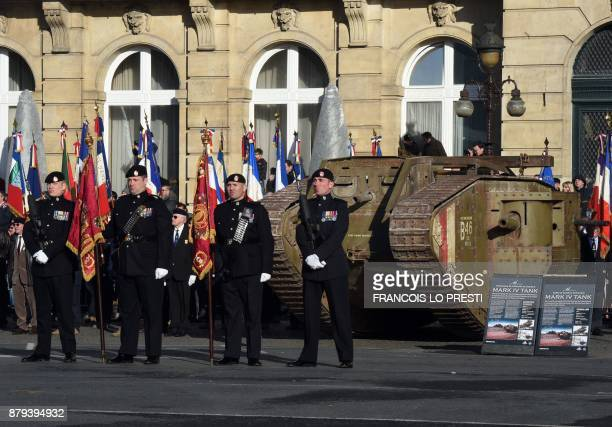 British troops walk past a replica of Britain's WWI Mark IV tank during a commemoration ceremony for the centenary of the Battle of Cambrai on...