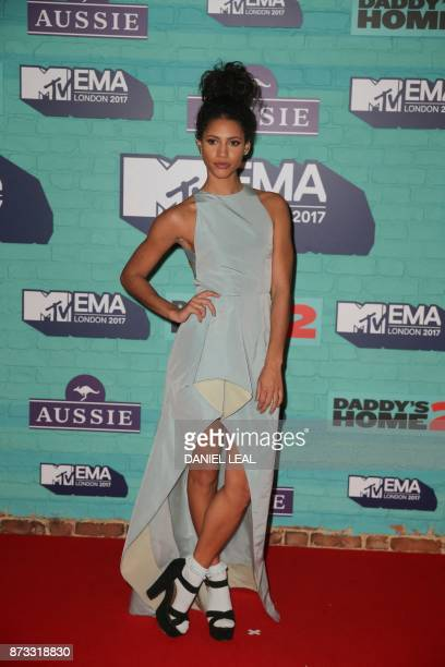 British TV and radio presenter Vick Hope poses on the red carpet arriving to attend the 2017 MTV Europe Music Awards at Wembley Arena in London on...