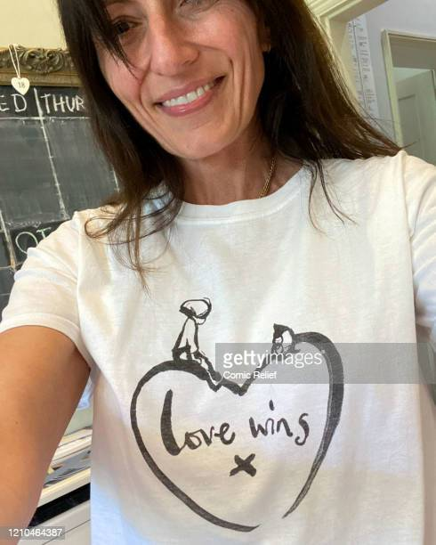 British TV presenter Davina McCall, wearing a limited-edition t-shirt created in collaboration with Charlie Mackesy featuring his beloved characters,...