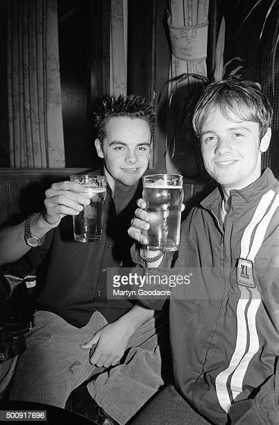 British TV presenters and actors Ant and Dec holding pints in a pub in Camden London United Kingdom 1994