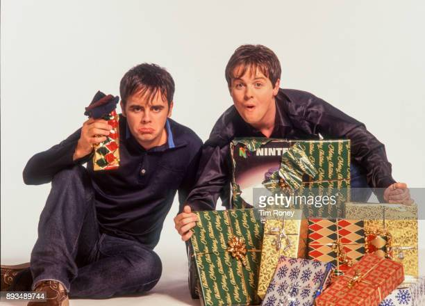 British TV presenters Ant And Dec Anthony McPartlin and Declan Donnelly portrait with christmas presents United Kingdom 2000