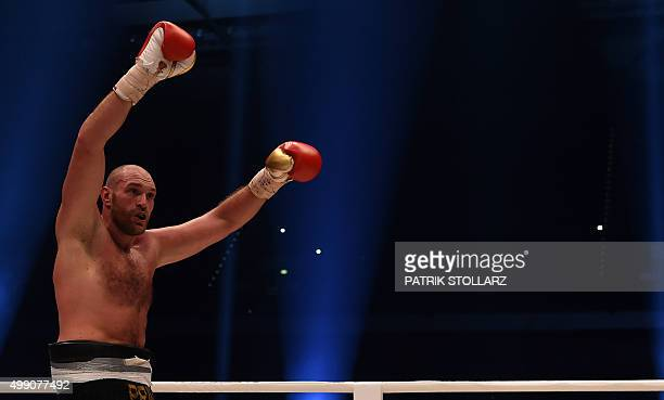 British Tyson Fury celebrates after the WBA IBF WBO and IBO title bout against Ukrainian world heavyweight boxing champion Wladimir Klitschko in...