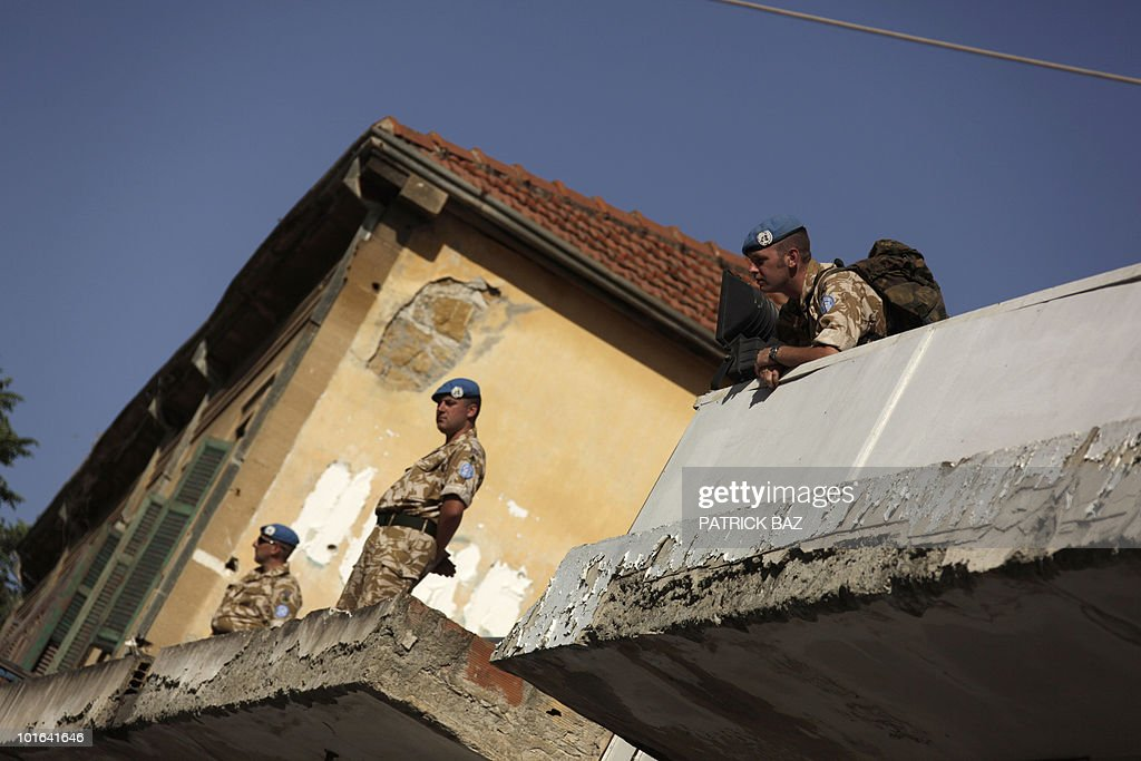 British UN peacekeepers guard a building facing Nicosia's Latin Church of the Holy Cross on the Green Line in the divided capital of Cyprus where Pope Benedict XVI celebrated mass on June 5, 2010, on the second day of his visit to the mainly Greek Orthodox east Mediterranean island.