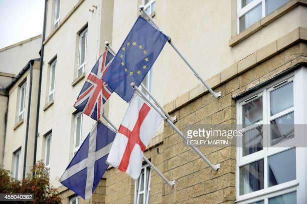 British Union EU Scottish and English flags fly on the facade of a building in Edinburgh on September 9 ahead of Scotland's independence referendum...