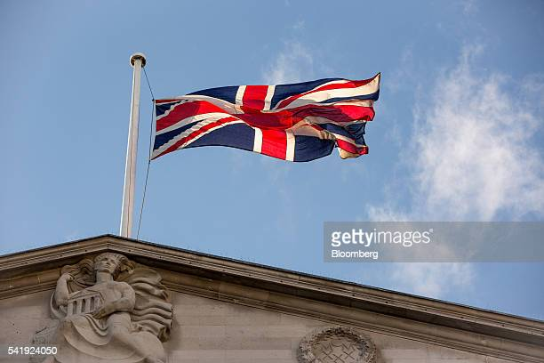 A British Union Flag also know as a Union Jack flies above the Bank of England in the City of London on Monday June 20 2016 British banks and their...